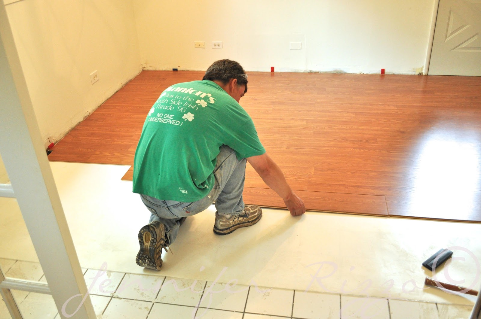 Can you install laminate flooring over tile